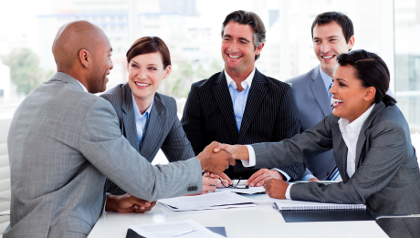 Multi-ethnic business people greeting each other